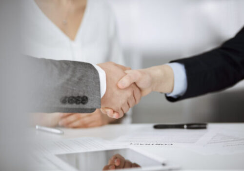 Business people shaking hands finishing contract signing, close-up. Business communication concept. Handshake and marketing.